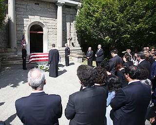 Fr. Joesph DiStefano prays during former state Sen. Harry Meshel's funeral, Sept. 9, 2017, at Belmont Park Cemetery in Youngstown...(Nikos Frazier | The Vindicator)