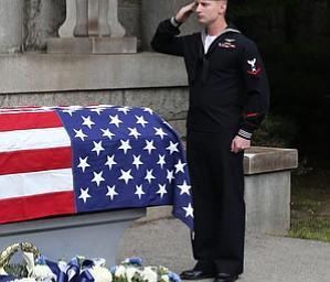 Gunners Mate Third Class Joshua Kramer of NOSC Youngstown salutes the casket bearing former state Sen. Harry Meshel's, Sept. 9, 2017, at Belmont Park Cemetery in Youngstown...(Nikos Frazier | The Vindicator)