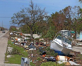 Debris from Hurricane Irma lays on the side of the Overseas Highway in Islamorda in the Florida Keys on Monday, Sept. 11, 2017, as Hurricane Irma passes. (Charles Trainor Jr/Miami Herald via AP)