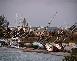 Damaged sail boats are shown in the aftermath of Hurricane Irma, Monday, Sept. 11, 2017, in the Florida Keys. (Matt McClain/The Washington Post via AP, Pool)