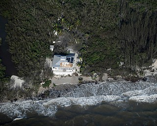 Damage to a roof is shown in the aftermath of Hurricane Irma, Monday, Sept. 11, 2017, in South West coast of Florida. (Matt McClain/The Washington Post via AP, Pool)