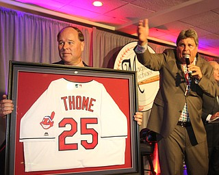 William D Lewis The vindicator  Ed Muransky auctions off a signed Jim Thome jersey being held by Dana Balash during Magic of Michael event 9-13-17 at Lake Club.