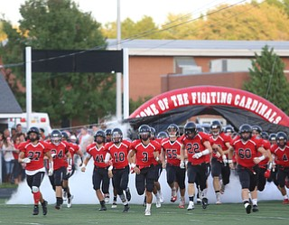 The canfield football team runs out onto the field before the first half as Struthers takes on Canfield, Friday, Sept. 22, 2017, at Canfield High School in Canfield. ..(Nikos Frazier | The Vindicator)..