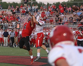 Canfield defensive back Paul Breinz(4) jumps up to try to block the pass intended for Struthers running back Tommy Kopnicky(3) in the first half as Struthers takes on Canfield, Friday, Sept. 22, 2017, at Canfield High School in Canfield. ..(Nikos Frazier | The Vindicator)..
