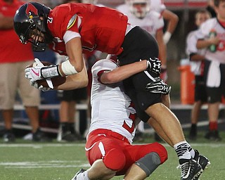 Canfield wide receiver Matt Zaremski(7) is taken down by Struthers defensive back Tommy Kopnicky(3) in the first half as Struthers takes on Canfield, Friday, Sept. 22, 2017, at Canfield High School in Canfield. ..(Nikos Frazier | The Vindicator)..