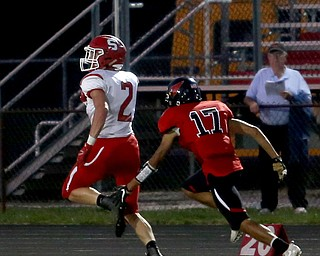 Struthers running back Nick Adams(2) returns the 99 yard kick return touchdown in the first half as Struthers takes on Canfield, Friday, Sept. 22, 2017, at Canfield High School in Canfield. Canfield defensive back Satyam Patel(17) attempts to bring him down...(Nikos Frazier | The Vindicator)..