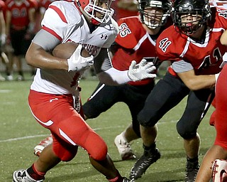 Struthers running back Wllie Mitchell(7) runs the ball in the first half as Struthers takes on Canfield, Friday, Sept. 22, 2017, at Canfield High School in Canfield. ..(Nikos Frazier | The Vindicator)..