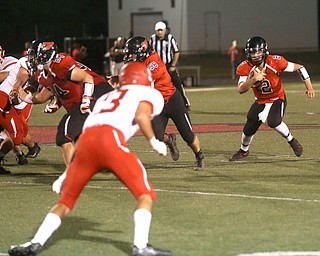Canfield quarterback Vinny Fiorenza(2) runs the ball in the first half as Struthers takes on Canfield, Friday, Sept. 22, 2017, at Canfield High School in Canfield. ..(Nikos Frazier | The Vindicator)..