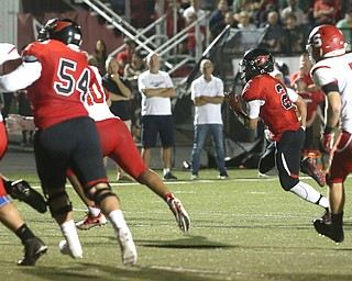 Canfield quarterback Vinny Fiorenza(2) runs the ball for a touchdown in the first half as Struthers takes on Canfield, Friday, Sept. 22, 2017, at Canfield High School in Canfield. ..(Nikos Frazier | The Vindicator)..