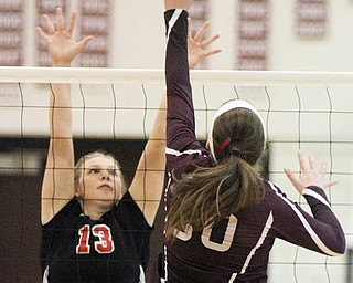 William D. Lewis The Vindicator  Canfield's Morgan Cleevely(13) blocks a shot from Boardman's Ashley Clark(30) during 10-9-17 action at Boardman.