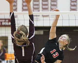 William D. Lewis The Vindicator  Canfield's Morgan Cleevely(13) shoots past Boardman's Carly Zilavy(1) during 10-9-17 action at Boardman.