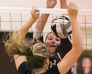 William D. Lewis The Vindicator  Canfield's Natalie Maras(23)) tries to block Boardman's Maria torres(28)) during 10-9-17 action at Boardman.