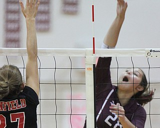 William D. Lewis The Vindicator  Canfield's Abbi Havrilla(27) tries to block Boardman's Maria torres(28)) during 10-9-17 action at Boardman.