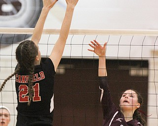 William D. Lewis The Vindicator  Canfield's Alexis Metille(24) blocks a shot from Boardman's Kaylin Burkey(15) during 10-9-17 action at Boardman.