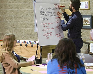 ROBERT K. YOSAY  | THE VINDICATOR..Andrew Rockway moderator makes notes during the group discussion.. First of three community meetings on the opioid epidemic, led by Your Voice Ohio. We are working with WFMJ and the WarrenTribune Chronicle -this was held at the Boys and Girls Club...-30-