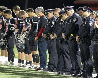 William D. Lewis The Vindicator  Girard football players and members of Girard PD observe a moment of silence for slain Girard PD officer Justin Leo before start of 10-17-17 game at Girard.