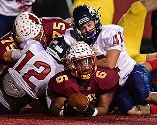 Cardinal Mooney's Andre McCoy, center, looks at the official for a call after being stopped short of the goal line by Fitch's Joey Zielinski (12) and Noah James (41) during the first half of their game Friday at Stambaugh Stadium. DAVID DERMER | THE VINDICATOR, Friday, Oct. 27, 2017