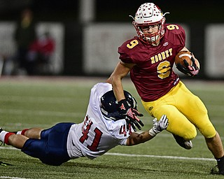 YOUNGSTOWN, OHIO - OCTOBER 27, 2017: Mooney's Jason Santisi runs through Fitch's Noah James during the first half of their game Friday night at Stambaugh Stadium. DAVID DERMER | THE VINDICATOR