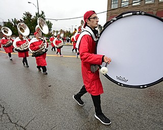 YOUNGSTOWN, OHIO - OCTOBER 28, 2017: YSU band member Kyle Rockwell of McDonald, Pennsylvania bangs on his bass drum on Fifth Avenue during the YSU homecoming parade, Saturday afternoon. DAVID DERMER | THE VINDICATOR