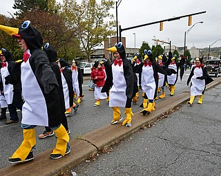 YOUNGSTOWN, OHIO - OCTOBER 28, 2017: People dressed up as penguins march on Fifth Avenue during the YSU homecoming parade, Saturday afternoon. DAVID DERMER | THE VINDICATOR