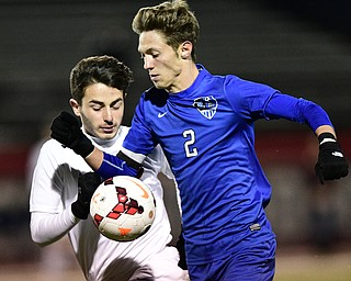 Lakeview's Noah Busefunk and Howland's Luke Brancaccio battle for the ball during the second half of their game Saturday night. DAVID DERMER | THE VINDICATOR