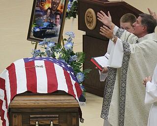 William D Lewis The vindicator  Msgr. John Zurw prays over casket of slain police officer Justin Leo.
