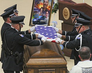 William D Lewis The vindicator Police honor guard folds flag on casket of slain Girard PD officer Justin Leo.
