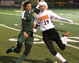Springfield Local midfielder Anna Rothwell (29) attempts to keep the ball away from Elyria Catholic midfielder Avery Doll (7) during the first half as Elyria Catholic High School takes on Springfield Local High School in the Division III Region 9 Regional Semi-Finals, Tuesday, Oct. 31, 2017, at Green Memorial Stadium in Uniontown. Elyria won 6-0...(Nikos Frazier | The Vindicator)..