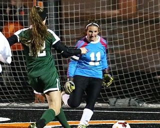 Elyria Catholic forward Ryan Kunkle (12) scores a goal against Springfield Local goalie Lex Slike (11) during the first half as Elyria Catholic High School takes on Springfield Local High School in the Division III Region 9 Regional Semi-Finals, Tuesday, Oct. 31, 2017, at Green Memorial Stadium in Uniontown. Elyria won 6-0...(Nikos Frazier | The Vindicator)..
