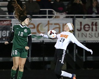Springfield Local midfielder Anna Rothwell (29) uses her chest to regain control of the ball against Elyria Catholic forward Ryan Kunkle (12) during the first half as Elyria Catholic High School takes on Springfield Local High School in the Division III Region 9 Regional Semi-Finals, Tuesday, Oct. 31, 2017, at Green Memorial Stadium in Uniontown. Elyria won 6-0...(Nikos Frazier | The Vindicator)..