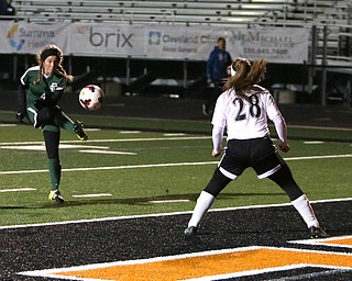 Elyria Catholic forward Emilie Uhnak (4) tries to kick in a goal against Springfield Local defender Shantel Springer (28) during the first half as Elyria Catholic High School takes on Springfield Local High School in the Division III Region 9 Regional Semi-Finals, Tuesday, Oct. 31, 2017, at Green Memorial Stadium in Uniontown. Elyria won 6-0...(Nikos Frazier | The Vindicator)..