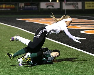 Springfield Local midfielder Cierra Latronica (24) and Elyria Catholic defender Riley Doll (22) collide during the second half as Elyria Catholic High School takes on Springfield Local High School in the Division III Region 9 Regional Semi-Finals, Tuesday, Oct. 31, 2017, at Green Memorial Stadium in Uniontown. Elyria won 6-0...(Nikos Frazier | The Vindicator)..