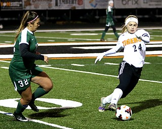 Springfield Local midfielder Cierra Latronica (24) tries to keep the ball away from Elyria Catholic midfielder Meredith Flanagan (32) during the second half as Elyria Catholic High School takes on Springfield Local High School in the Division III Region 9 Regional Semi-Finals, Tuesday, Oct. 31, 2017, at Green Memorial Stadium in Uniontown. Elyria won 6-0...(Nikos Frazier | The Vindicator)..