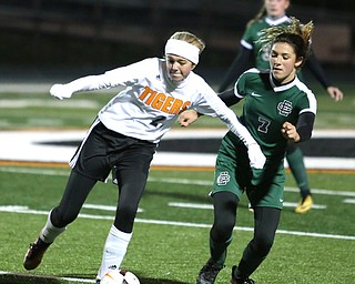 Springfield Local midfielder Anna Rothwell (29) tries to keep Elyria Catholic midfielder Avery Doll (7) away from the ball during the second half as Elyria Catholic High School takes on Springfield Local High School in the Division III Region 9 Regional Semi-Finals, Tuesday, Oct. 31, 2017, at Green Memorial Stadium in Uniontown. Elyria won 6-0...(Nikos Frazier | The Vindicator)..