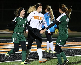 Elyria Catholic forward Emilie Uhnak (4) is congradulated by Elyria Catholic midfielder Avery Doll (7) after scoring a goal against Springfield Local goalie Lex Slike (11) during the second half as Elyria Catholic High School takes on Springfield Local High School in the Division III Region 9 Regional Semi-Finals, Tuesday, Oct. 31, 2017, at Green Memorial Stadium in Uniontown. Springfield Local defender Hayley Socha (12) walks by in the center. Elyria won 6-0...(Nikos Frazier | The Vindicator)..