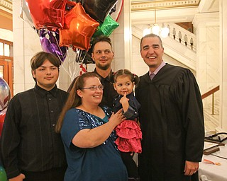 ROBERT K. YOSAY  | THE VINDICATOR..the new family... . Jakob ()ok)  shawn Teresa and Jacqueline Wolfe and Judge Robert N Rusu Jr..A young girl found a new home as Judge Robert N. Rusu of Mahoning County Probate Court presided over her adoption in the courthouse rotunda during the countyÕs fourth Adoption Day celebrationÓ ...-30-