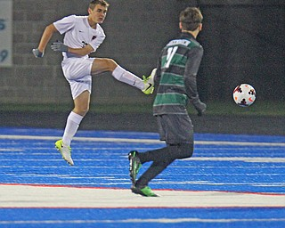 WILLIAM D LEWIS  | THE VINDICATOR..Howland #33  Gabe Altawil  moves the ball away from Aurora Defender #11  Nate Malinowski during Division II regional semifinal boys soccer Howland vw Aurora at Ravenna Stadium..-30-