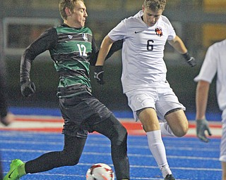 WILLIAM D LEWIS  | THE VINDICATOR..Aurora #12 Cade Huffman and Holwand #6 Matt Seem  battle for the ball in first half action at Division II regional semifinal boys soccer Howland vw Aurora at Ravenna Stadium..-30-