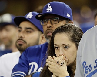 Fans watch during the eighth inning of Game 7 of baseball's World Series between the Houston Astros and the Los Angeles Dodgers Wednesday, Nov. 1, 2017, in Los Angeles. (AP Photo/David J. Phillip)