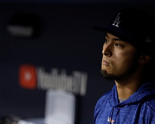 Los Angeles Dodgers' Yu Darvish watches from the dugout during the eighth inning of Game 7 of baseball's World Series against the Houston Astros Wednesday, Nov. 1, 2017, in Los Angeles. (AP Photo/Matt Slocum)