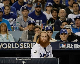 Los Angeles Dodgers' Justin Turner watches during the eighth inning of Game 7 of baseball's World Series against the Houston Astros Wednesday, Nov. 1, 2017, in Los Angeles. (AP Photo/David J. Phillip)