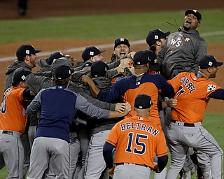 Members the the Houston Astros celebrate their win against the Los Angeles Dodgers in Game 7 of baseball's World Series Wednesday, Nov. 1, 2017, in Los Angeles. The Astros won 5-1 to win the series 4-3. (AP Photo/Alex Gallardo)