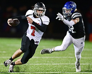 CORTLAND, OHIO - NOVEMBER 3, 2017: Girard's Mark Waid, left, runs the ball away from Lakeview's Alec Bartholomew during the first half of the OHSAA playoff game, Friday night at Lakeview High School. DAVID DERMER   THE VINDICATOR