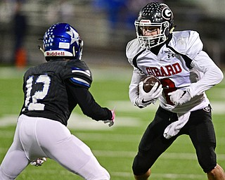 CORTLAND, OHIO - NOVEMBER 3, 2017: Girard's Michael Belcik, right, runs before being hit by Lakeview's Michael Hill during the first half of the OHSAA playoff game, Friday night at Lakeview High School. DAVID DERMER   THE VINDICATOR