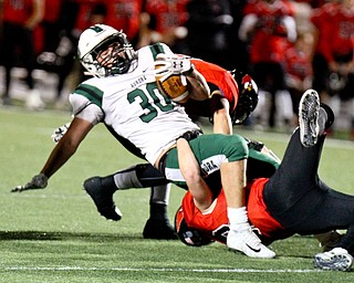 William D Lewis The Vindicator  Canfield's Tyler Dobrindt(22) tackles Aurora's Brent Henderson(30)during 11-3-17 playoff action with Aurora at Canfield.
