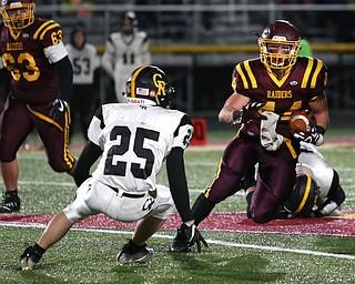 South Range's Peyton Remish(44) weaves to avoid Crestview's Danny Moore(25) during the first quarter as Crestview High School takes on South Range High School, Friday, Nov. 3, 2017, at Raider's stadium at the Rominger Sports Complex in Canfield...(Nikos Frazier | The Vindicator)..