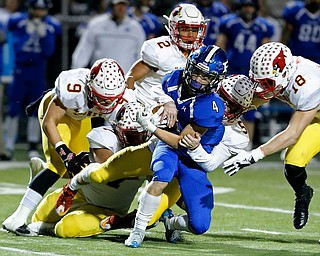 POLAND, OHIO - NOVEMBER 3, 2017:   Poland's Mike Diaz (4) is stopped after picking up a 1st down by Mooney's Nico Marchionda (5) during the1st qtr. at Poland Stadium. MICHAEL G TAYLOR | THE VINDICATOR