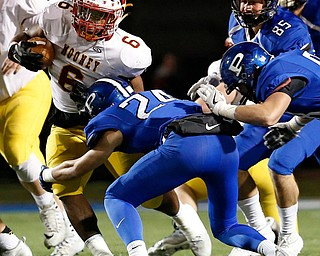 POLAND, OHIO - NOVEMBER 3, 2017:   Mooney's Andre McCoy (6) is tackled by Poland's Tarren Amill (24) during the1st qtr. at Poland Stadium. MICHAEL G TAYLOR | THE VINDICATOR