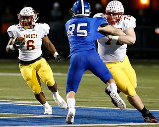 POLAND, OHIO - NOVEMBER 3, 2017:   Mooney's Andre McCoy (6) runs for a 1st down as his teammate Kyle Jornigan (72) blocks Poland's Nick Miller (85) during the1st qtr. at Poland Stadium. MICHAEL G TAYLOR | THE VINDICATOR