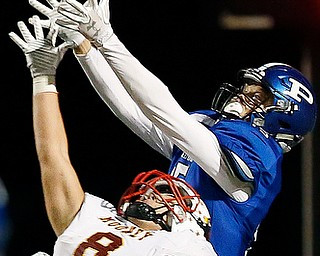 POLAND, OHIO - NOVEMBER 3, 2017:   Poland's Nate Alessi (15) tries to make a desparate, last play 4th down pass but it is knocked away by Mooney's Brennan Olesh (8) during the 4th qtr. at Bulldog Stadium. MICHAEL G TAYLOR | THE VINDICATOR